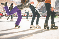 Funny teenagers girls and boy skating outdoor, ice rink Stock Photos