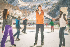Funny teenagers girls and boy skating outdoor, ice rink stock image