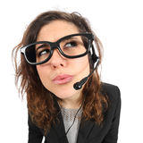 Funny telephone operator agent thinking and looking sideways Stock Photos