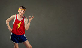 Funny thin man in sports clothes shows his hand okay. Stock Images