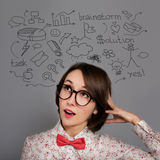 Funny Thinking Hipster Girl with Many Ideas Stock Photography