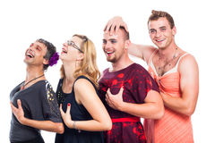 Funny three men cross-dressing and one woman Stock Image