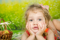 Funny three year old girl on a picnic Stock Images