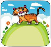Funny Tiger on green hill. Royalty Free Stock Images