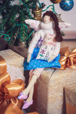 Funny tilda angel girl sitting on new year gifts Royalty Free Stock Photography