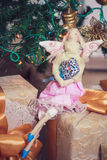 Funny tilda angel girl sitting on new year gifts Stock Images