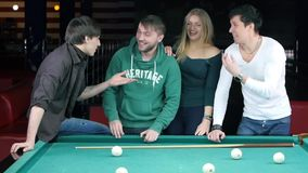 Funny time with friends in billiard club. Slow stock video
