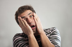 Funny tired man. Portrait of a funny tired man looking at camera, gray background Stock Image