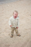 Funny toddler baby cries outdoors Stock Photos