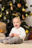 Funny toddler boy in christmas interior Stock Photography