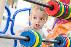Funny toddler boy on the playground Stock Photos
