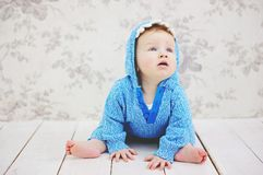 Funny toddler girl in a blue sweater Royalty Free Stock Image