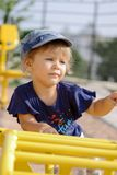 Toddler girl climbing on the playground Royalty Free Stock Photo