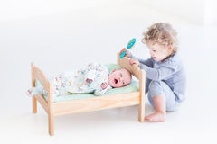 Funny toddler girl with her newborn baby brother i Stock Images