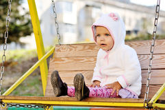 Funny toddler girl on swing Royalty Free Stock Photography