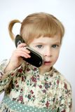 Funny toddler girl talking mobile cell phone stock photos