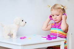 Funny toddler playing doctor indoors Royalty Free Stock Photography