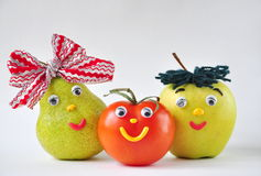 Funny tomato, apple and pear on a white background Stock Photos