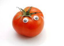 Funny tomato with eyes isolated Royalty Free Stock Photos
