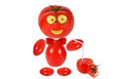 Funny tomato  smiles and keeps tomato juice Royalty Free Stock Image
