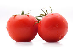 Funny tomatoes. Two red wet tomatoes on a white background with shadow Stock Photo