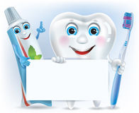 Funny tooth, tooth paste and tooth brush with blan Royalty Free Stock Photography