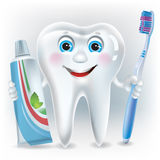 Funny tooth with toothpaste and toothbrush Royalty Free Stock Photography