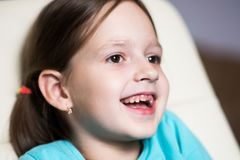 Funny toothless girl laughing with his mouth open. Funny toothless girl laughing in his room Stock Images