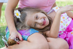 Funny toothless little girl with her mother Stock Photos