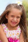Funny toothless little girl outdoors Royalty Free Stock Images