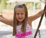 Funny toothless little girl on a playground Stock Photography