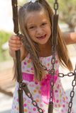 Funny toothless little girl on a playground Royalty Free Stock Photo