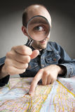 Funny tourist discovering map Stock Photo