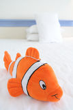 Funny toy on hotel bed Royalty Free Stock Photo