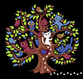 Funny tree. Tree with cats and birdies Stock Image