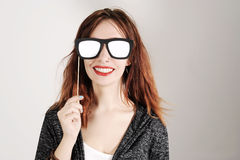 Funny trendy fashion girl with paper glasses playing with emotion Stock Photography