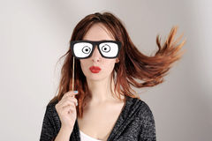 Funny trendy fashion girl with paper glasses playing with emotion Stock Photo