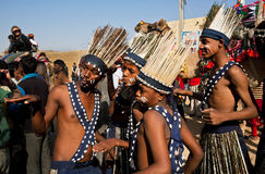 Funny tribal dancing people from African continent stock images