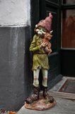Funny troll. Funny figure of troll in front of store window Stock Photos