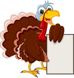 Funny turkey cartoon posing with blank sign Royalty Free Stock Photos