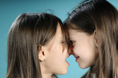 Funny twin sisters in conflict Stock Photography