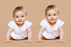 Funny twins baby. On background Royalty Free Stock Images