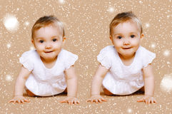 Funny twins baby. With snow Stock Photo