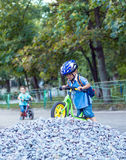 Funny two active little boys riding on bicycle Royalty Free Stock Images