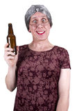 Funny Ugly Mature Senior Woman Drunk Drinking Beer. Funny ugly drunk mature senior woman who is drunk. Granny is drinking beer and feeling a nice buzz. Grandma Royalty Free Stock Photography
