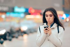 Stressed Woman Checking Her Phone And Walking on the Street Stock Image