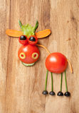 Funny vegetable cook with fork and spoon stock images