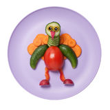 Funny vegetable peacock compiled on pink plate Royalty Free Stock Photos