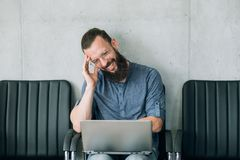 Funny videos idle leisure man laughs watch laptop. Funny videos and idle leisure concept. man laughs watching entertaining website on laptop stock photo