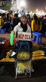 Funny of Vietnamese street food vendor at night outdoor market Royalty Free Stock Images